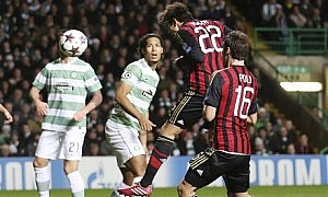 Kaká rises unmarked to head Milan's opening goal in the win against Celtic.