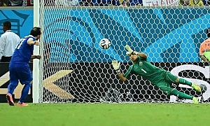 Costa Rica's goalkeeper Keylor Navas saves from Greece forward Fanis Gekas in the penalty shoot-out